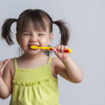 How to Begin Teaching Your Child to Brush Her Teeth